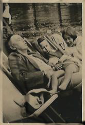 Joan, with Harry, John and her Dad asleep on the beach at Yarmouth.